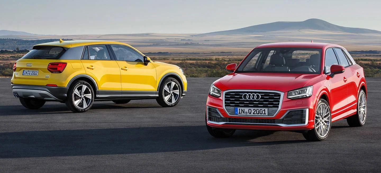 Modelos Audi amarillo y rojo